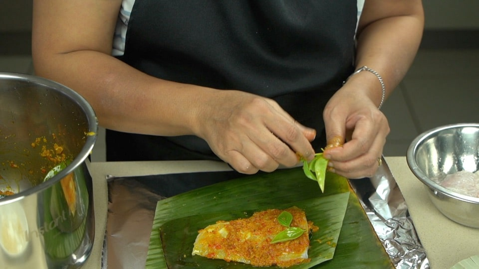 wrap the fish in banana leaves