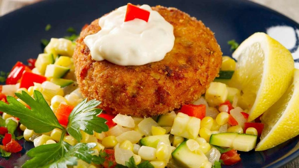 How do you heat up already cooked crab cakes?